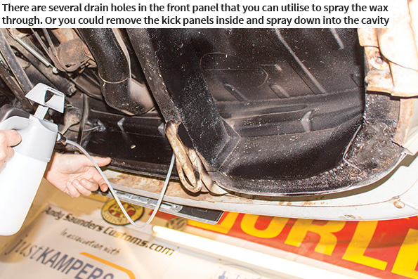 There are several drain holes in the front panel that you can utilise to spray the wax through. Or you could remove the kick panels inside and spray down into the cavity